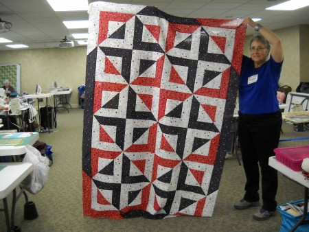 Barbara S. shows her Quilt of Honor