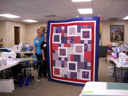 Karen M. shows her Quilt of Honor