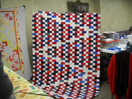 Karen S. shows her Quilt of Honor